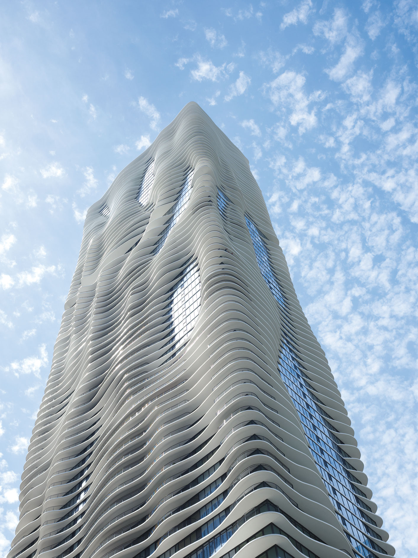 Studio Gang, Aqua Tower, Chicago, Illinois, USA, 2010.  The Aqua Tower's floor plates were shaped to give residents sight lines to specific Chicago landmarks as well as to provide solar shading and help break up the wind. The cantilevered, curvilinear slabs produce an elevation with variegated light and shadow as well as the appearance of undulating movement when seen from below. Steve Hall © Hall + Merrick