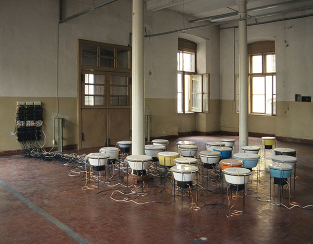 Shedding Skin (Perpetual Current for 24 buckets) by Nina Canell (2008)