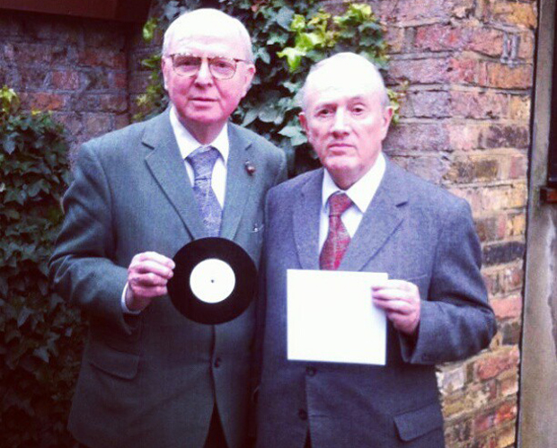 Gilbert & George with their bare sleeve. Courtesy of Secret 7