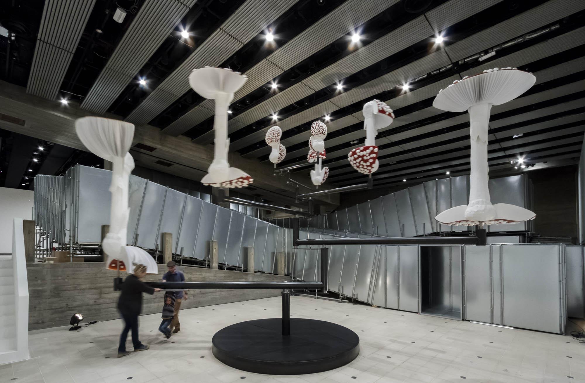 "Carsten Höller, Flying Mushrooms, 2015, Installation view, ""Carsten Höller: Decision,"" Hayward Gallery, London, 2015 Polyester mushroom replicas, polyester paint, synthetic resin, acrylic paint, wire, putty, polyurethane, rigid foam, stainless steel 16' 8 3/8"" × 28' 3 3/8"" × 28' 3 3/8"" (5.1 × 8.6 × 8.6 m) Artwork © Carsten Höller. Photo by Ela Bialkowska. Courtesy Gagosian."