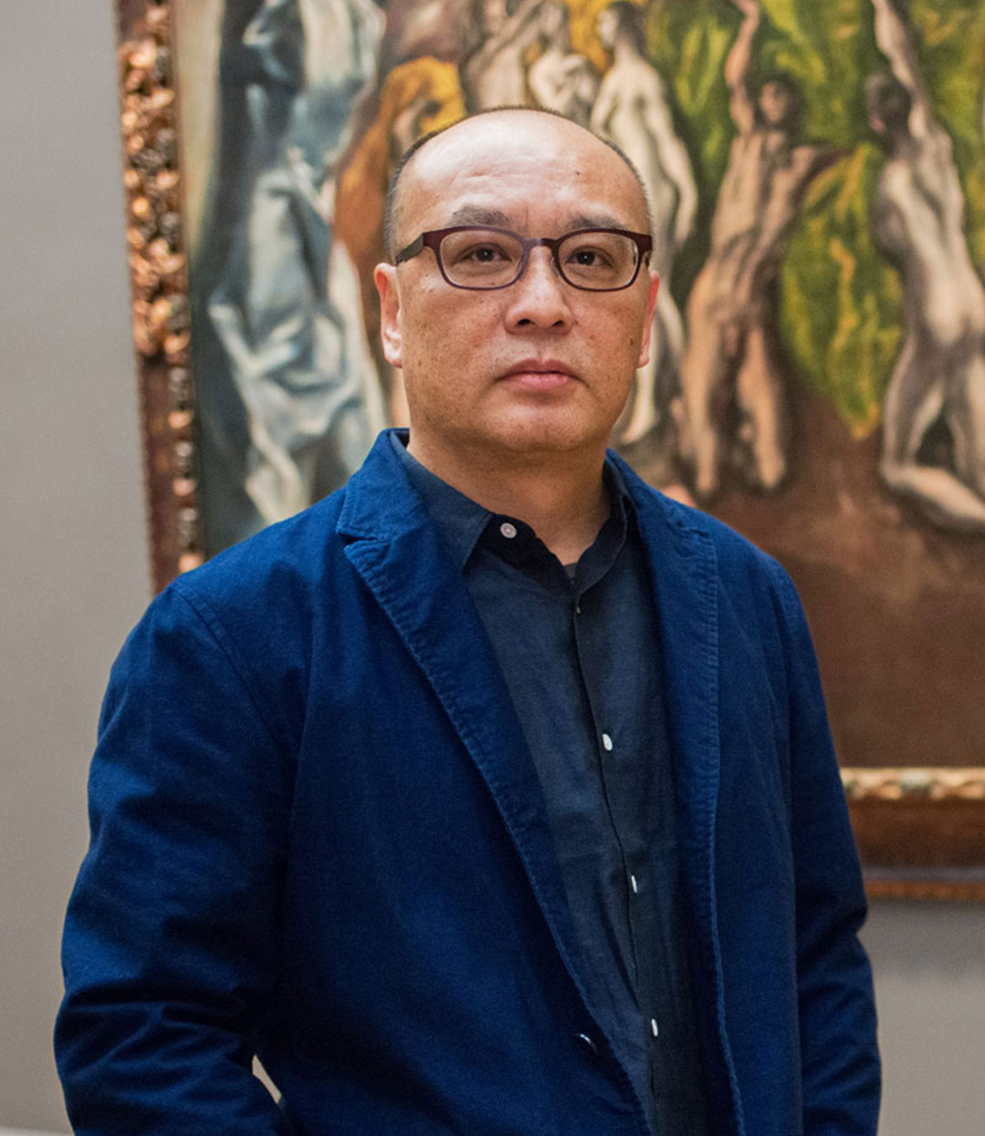 Zhang Xiaogang beside The Vision of Saint John (c. 1609–14) by El Greco, as featured in The Artist Project