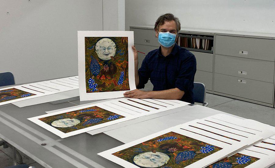 Marcel Dzama with his Artspace edition, The illumination of the sisters of paradise, 2020 - photo Lower East Side Printshop, October 2020