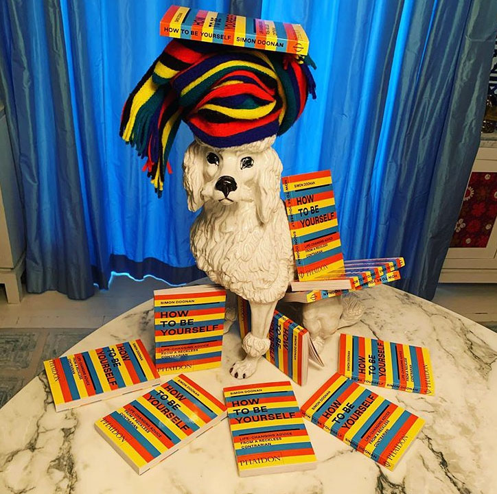 Simon Doonan works a lovely scarf and even lovelier dog model into his new display for his book How to Be Yourself