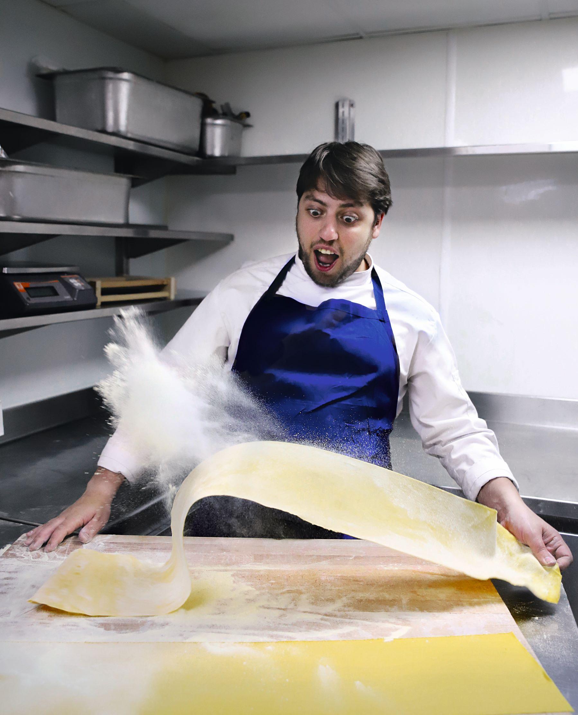 Big Mamma chef Rocco Dimartino making pasta, as featured in our new book Big Mamma Cucina Popolare