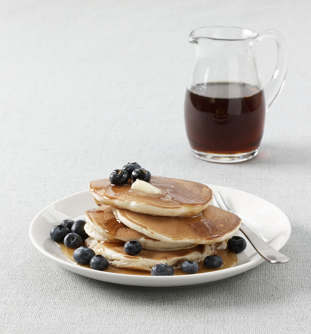 Buttermilk pancakes with blueberries and syrup, as featured in Simple & Classic