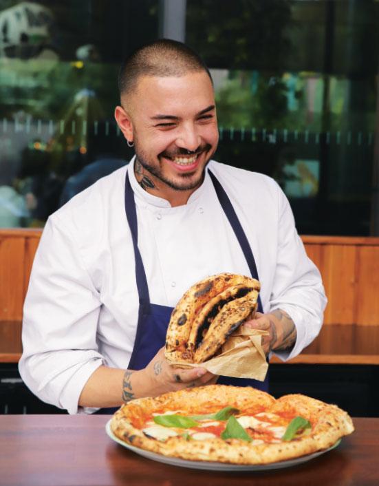 Andrea de Michele with a Pizza al portafoglio, as reproduced in Big Mamma