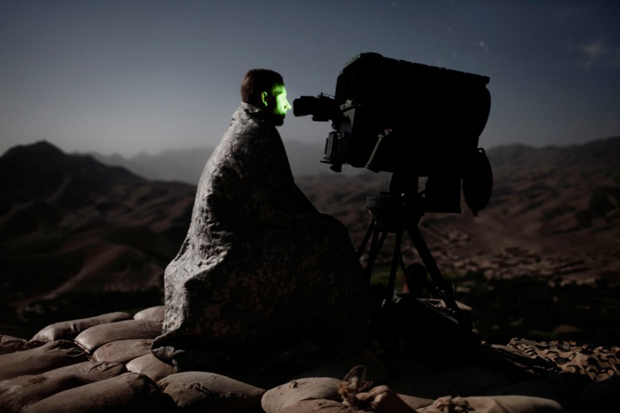 Adam Ferguson - Wardak, Afghanistan 2009. A US soldier surveys a road with a long range acquisition sight