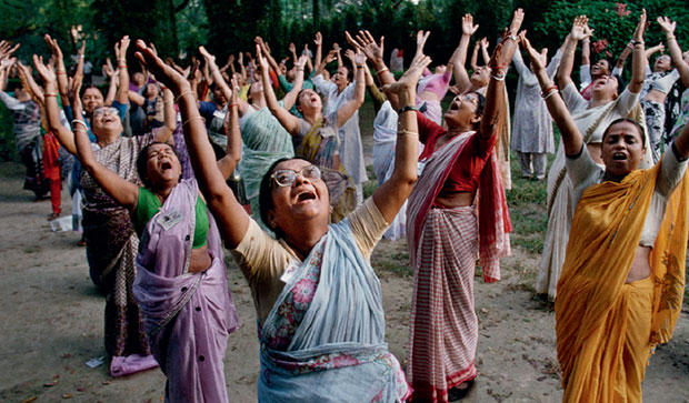 Women participate in a laughter club at Mumbai's Hanging Gardens - Steve McCurry from the book India