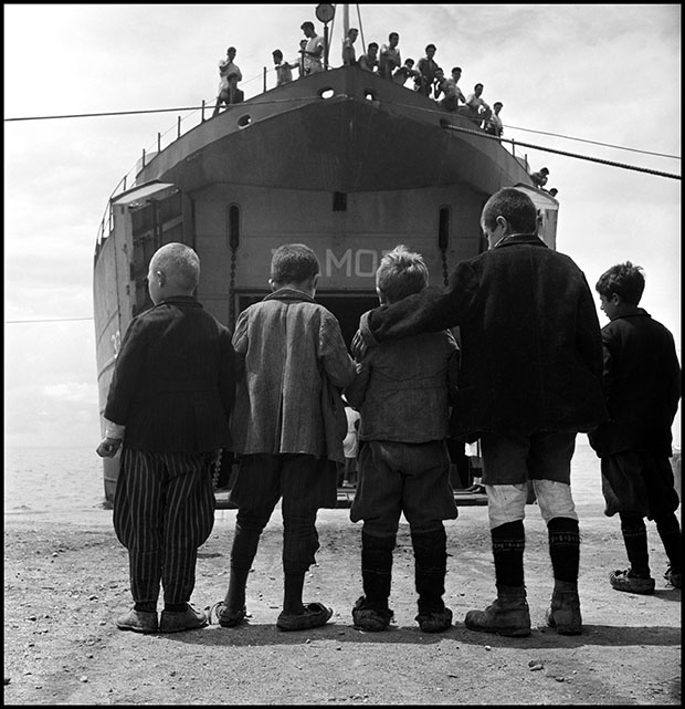 Five boys from Promahi in front if the refugee ship S.S Samos that evacuated children during the Civil War. Greece, 1948 © David Seymour / Magnum Photos